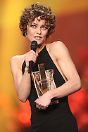 PARIS, FRANCE - FEBRUARY 14:  Singer Vanessa Paradis receives the 'Artiste Interprete Feminine' award during the 'Les Victoires de la musique 2014' ceremony at Le Zenith on February 14, 2014 in Paris, France.  (Photo by Tony Barson/FilmMagic)