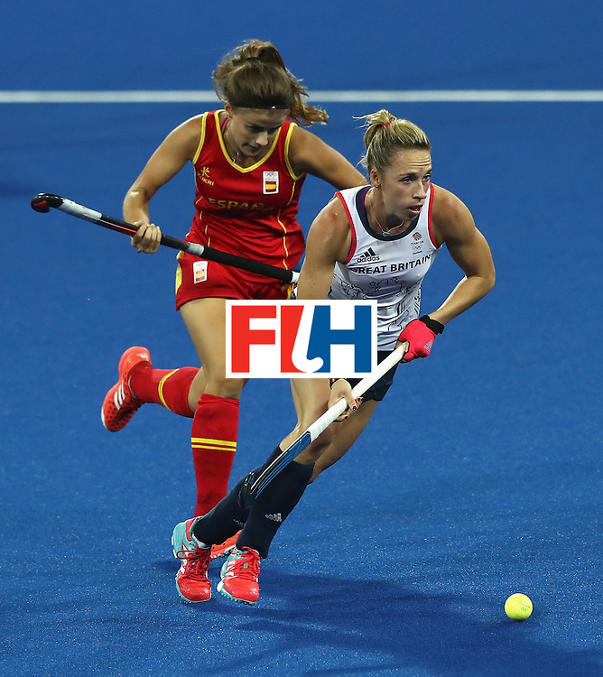 RIO DE JANEIRO, BRAZIL - AUGUST 15:  Susannah Townsend of Great Britain moves away with the ball during the Women's quarter final hockey match between Great Britain and Spain on Day10 of the Rio 2016 Olympic Games held at the Olympic Hockey Centre on August 15, 2016 in Rio de Janeiro, Brazil.  (Photo by David Rogers/Getty Images)