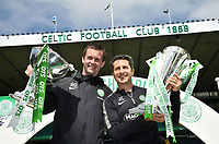 24/05/15 SCOTTISH PREMIERSHIP<br /> CELTIC v INVERNESS CT<br /> CELTIC PARK - GLASGOW <br /> Celtic manager Ronny Deila (left) and assistant John Collins celebrate with the Scottish League Cup and the Scottish Premiership trophy<br /> ** IMAGE IS FREE FOR USE ON MONDAY 25/05/15 **