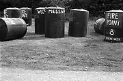 Water butts in a field, Glastonbury, Somerset, 1989