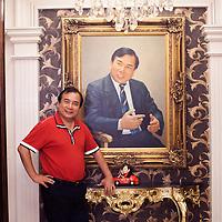 BEJING, JUNE 2013 : Multi -Millionaer Li Xiaohua in seinem Pekinger Penhouse vor einem Portrait, dass ihn selbst zeigt. Li war China's erster Ferrari Fahrer und u.a. das Vorzeigesymbol fuer viele auslaendische Staatsgaeste. Li ist jetzt im Ruhestand und widmet sich hauptsaechlich dem Pekinger Elite Club, der von ihm gegruendet wurde.