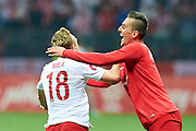 Poland's Sebastian Mila (L) celebrates after scoring with Poland's Arkadiusz Milik first scorer during the EURO 2016 qualifying match between Poland and Germany on October 11, 2014 at the National stadium in Warsaw, Poland<br /> <br /> Picture also available in RAW (NEF) or TIFF format on special request.<br /> <br /> For editorial use only. Any commercial or promotional use requires permission.<br /> <br /> Mandatory credit:<br /> Photo by &copy; Adam Nurkiewicz / Mediasport
