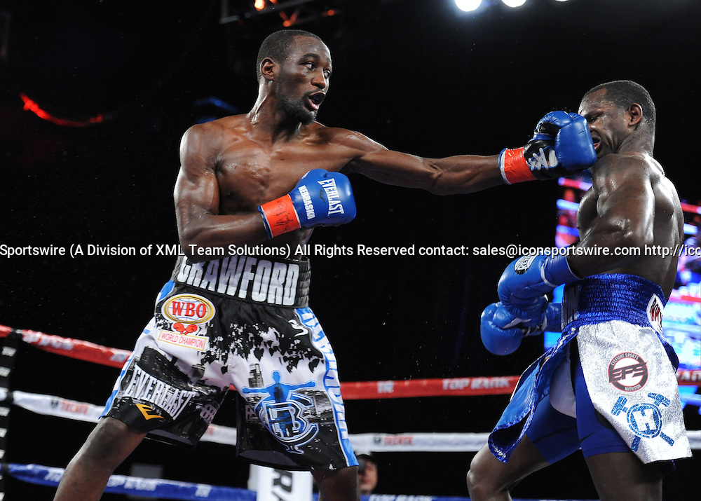 February 27, 2016:  Terrance Crawford lands a hook as he retains the WBO Lightweight title by TKO of Round 5, while in action against Henry Lundy during a boxing match at the Theater at Madison Square Garden in New York, New York