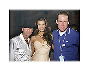 Kenny Chesney, Ali Landry  &amp; Brian Philips CMT Senior VP/General Mananger at the Post Party celebration for the first ever CMT Flameworthy Video Music Awards at the Gaylord Entertainment Center in Nashville Tennesee. 6/12/02<br /> Photo by Rick Diamond/PictureGroup.