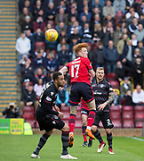 28th April 2018, Fir Park, Motherwell, Scotland; Scottish Premier League football, Motherwell versus Dundee; Sofien Moussa of Dundee bets Charles Dunne of Motherwell in the air