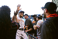 PHOENIX, AZ - MAY 14:  Hunter Pence #8 of the San Francisco Giants is congratulated by teammates after hitting a two run home run during the fourth inning of the game against the Arizona Diamondbacks at Chase Field on May 14, 2016 in Phoenix, Arizona.  (Photo by Jennifer Stewart/Getty Images)