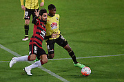 Roly Bonevacia (R of the Phoenix is tackled by West Sydney's Dimas Delgado during the A-League - Wellington Phoenix v Western Sydney football match at Westpac Stadium in Wellington on Sunday the 10 April 2016. Copyright Photo by Marty Melville / www.Photosport.nz