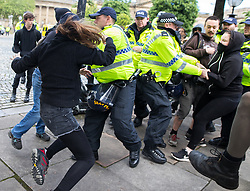 © Licensed to London News Pictures . 03/06/2017 . Liverpool , UK . Police and anti fascists clash . Hundreds of police manage a demonstration by the far-right street protest movement , the English Defence League ( EDL ) and an demonstration by opposing anti-fascists , including Unite Against Fascism ( UAF ) . Photo credit: Joel Goodman/LNP
