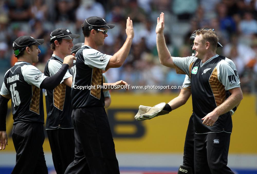 James Franklin and Scott Styris celebrate a wicket. Twenty20 International Cricket match between The New Zealand Black Caps and Pakistan at Eden Park on Boxing Day, Sunday 26 December 2010. Photo: Andrew Cornaga/photosport.co.nz