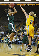 January 27 2010: Michigan St. guard Brittney Thomas (20) puts up a shot over Iowa guard Kamille Wahlin (2) during the second half of an NCAA women's college basketball game at Carver-Hawkeye Arena in Iowa City, Iowa on January 27, 2010. Iowa defeated Michigan State 66-64.