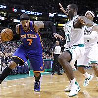 04 March 2012: New York Knicks small forward Carmelo Anthony (7) drives past Boston Celtics power forward Brandon Bass (30) and Boston Celtics small forward Paul Pierce (34) during the Boston Celtics 115-111 (OT) victory over the New York Knicks at the TD Garden, Boston, Massachusetts, USA.
