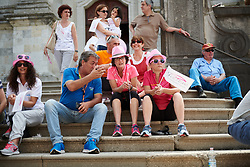 Fans wait on the church steps to watch sign on at Giro Rosa 2018 - Stage 9, a 104.7 km road race from Tricesimo to Monte Zoncolan, Italy on July 14, 2018. Photo by Sean Robinson/velofocus.com
