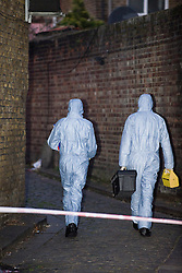 © Licensed to London News Pictures. 02/01/2012. London, UK. Police and forensics at the scene on Ryder Mews, East London where a woman thought to have been abducted from a house in Hackney has been found dead in an abandoned car. Photo credit :LNP