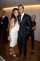 ARMIE HAMMER and ELIZABETH CHAMBERS at a reception to launch the range of Dr Lancer beauty products held at The Penthouse, Harrods, Knightsbridge, London on 16th September 2013.