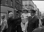 Maureen Potter with The Dublin Fire Brigade..1986..19.07.1986..07.19.1986..19th July 1986..Dublin Fire Brigade aided and abetted by Maureen Potter staged a collection,today,in aid of The Royal Victoria Eye and Ear Hospital,Adelaide Road,Dublin. It is hoped that the proceeds would go towards the purchase of a laser eye scanner. The Eye and Ear Hospital was established in 1897 and has served not only Dublin but the whole country as well...No one was safe! picture shows that even fellow fund raisers contributed to the collection.