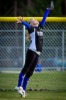 Coeur d'Alene High's Randi Spencer stretches out to make the catch in deep right field during Wednesday's game against Lake City.