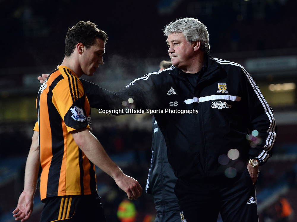 26 March 2014 - Barclays Premier League - West Ham United v Hull City - Steve Bruce, Manager of Hull City with own goal scorer, James Chester - Photo: Marc Atkins / Offside.
