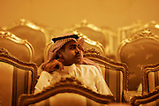 A Saudi guest sits among ornate chairs during a welcoming party for guests and delagations of the Arab League Summit hosted by Saudi Officials March 27, 2007 at the al-Athriyah Village just outside the Saudi capital, Riyadh. Arab leaders arrived in Riyadh today for the yearly summit of Arab nations that begins tomorrow.