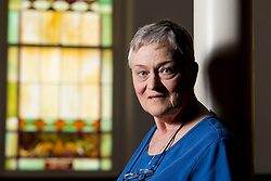 Mary Love was a victim of predatory payday lending when she borrowed money at a rate of 400% and it took years and debt counseling to become debt free.  Representitive Darryl Owens D-Louisville proposed a bill that would cap the percentage at 36% but it was struck down in committee. <br /> <br /> Love posed for a portrait while working at Crescent Hill Presbyterian Church in Louisville, Friday, July 01, 2016