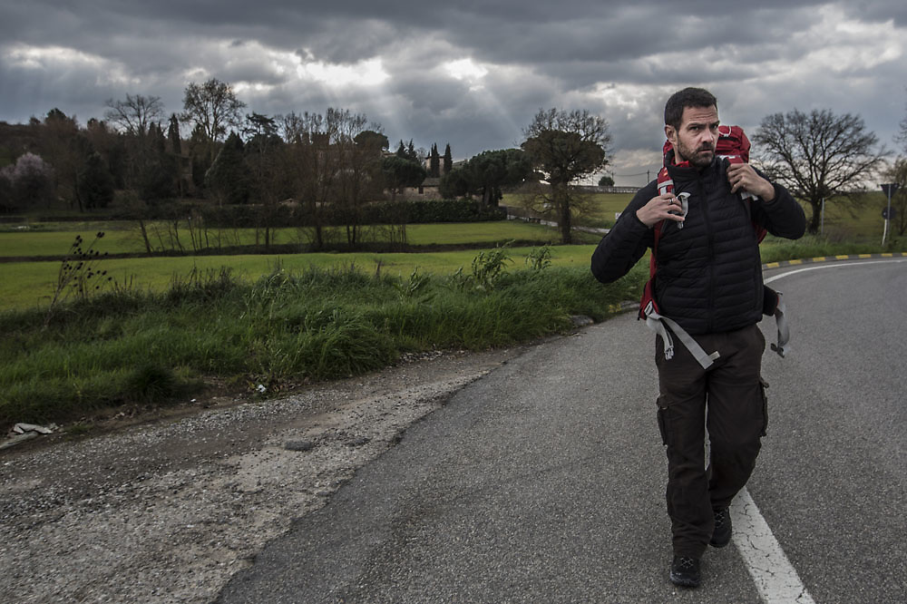 Former Societé Génerale trader Jerome Kerviel , walks in in Tuscany on his way to Siena, on March 6 2014.Following a brief meeting with Pope Francis in February, Jerome decided to walk back to France following the footsteps of the ancient Francigena route. Kerviel,  of French securities firm Société Générale  was charged with losing more than $7 billion in company assets by conducting a series of unauthorized and false trades between 2006 and early 2008.Kerviel 's last sentence verdict is fixed for the 19th of march.If the accusation will be confirmed he risks three years in prison for his role in one of the world's biggest trading scandals.