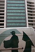 The graphic showing a person delivering a package, on the side of a courier's van, passing beneath corporate offices in the City of London, the capital's financial district, on 4th February 2020, in London, England.