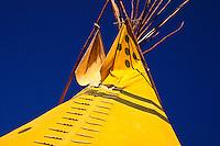 Yellow Tipi against dark blue sky