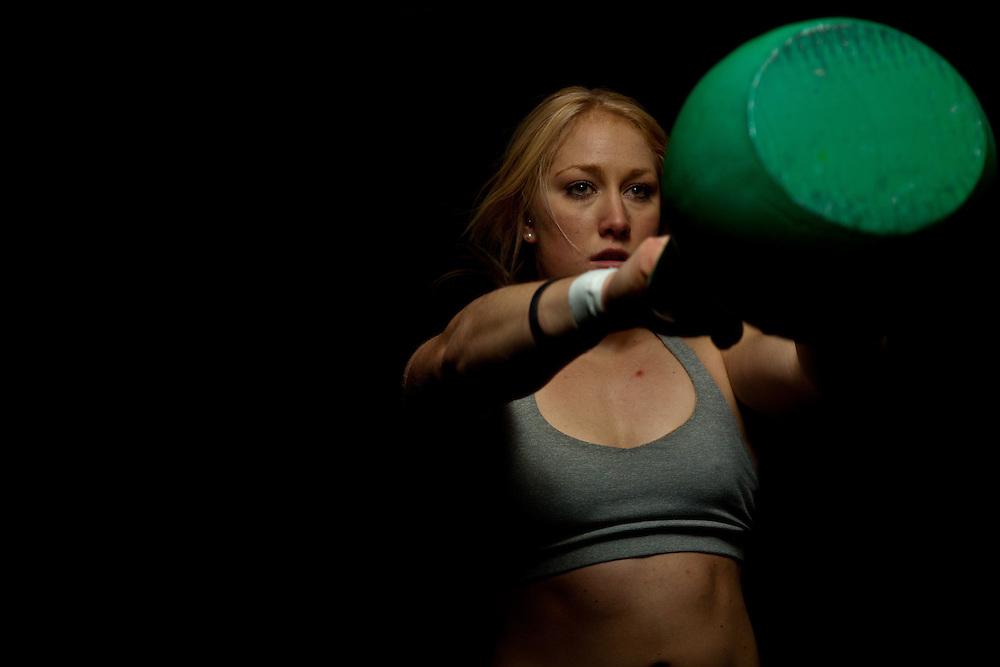 Jaelyn Wolf at Progressive Fitness Crossfit getting ready to start kettlebell swings