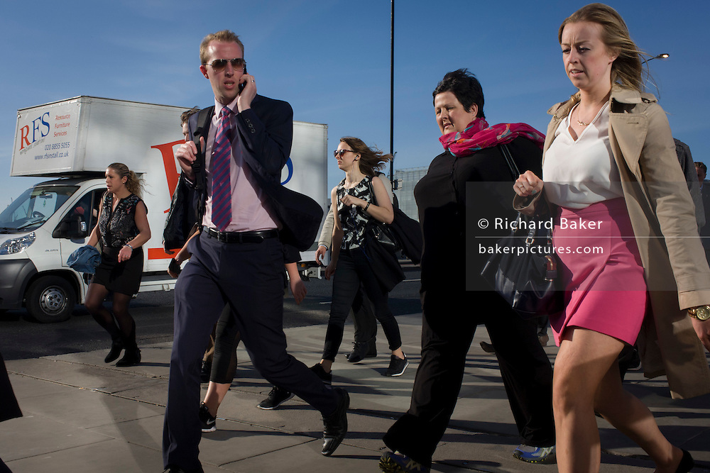 Man admires women while crossing southbound over London Bridge during the evening rush hour.