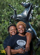 Tamokia Thompson, left, poses for a photograph with her daughter, Cienna Alley, right, at Fondren Middle School, September 9, 2014.