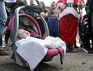 LEVITTOWN, PA -  DECEMBER 28:  Hannah Rose Ginion, whose battle with Krabbe disease inspired a law to update Pennsylvania's newborn screening list, died December 28, 2014. In this file photo, Hannah Rose Ginion sits in her carrier as Santa and visitors sing Christmas Carols at the Pizzullo home December 21, 2013 in Levittown, Pennsylvania. Hannah was born with Krabbe, a genetic disorder that affects both the central and peripheral nervous systems. The family is fighting to make newborn screening for the disorder a state law. (Photo by William Thomas Cain/Cain Images)