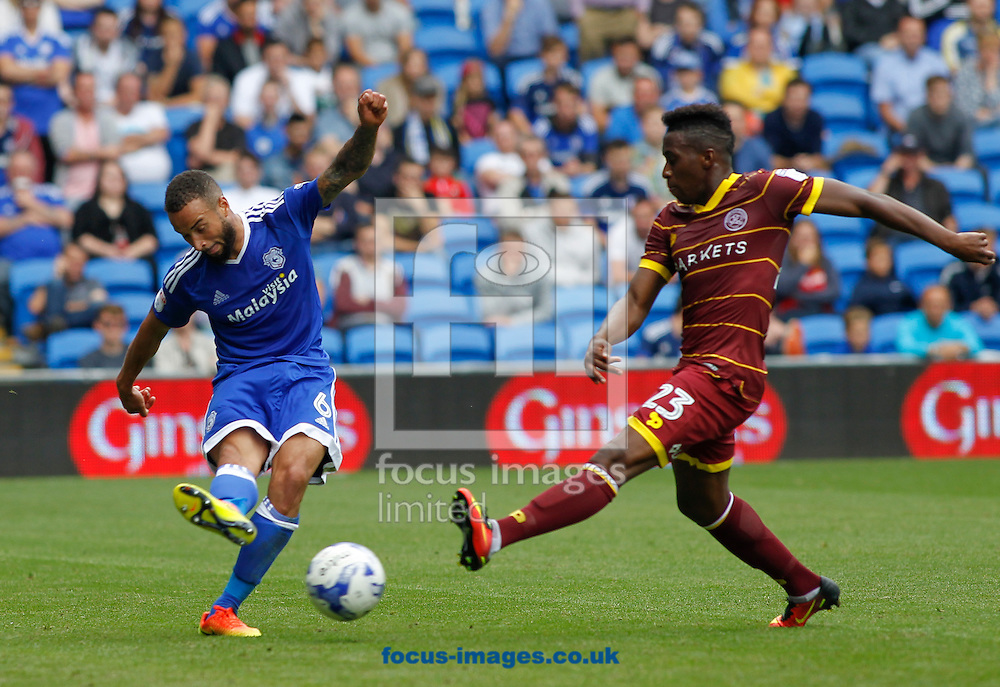 Jazz Richards of Cardiff City and Yeni Ngbakoto of Queens Park Rangers during the Sky Bet Championship match at the Cardiff City Stadium, Cardiff<br /> Picture by Mike Griffiths/Focus Images Ltd +44 7766 223933<br /> 14/08/2016