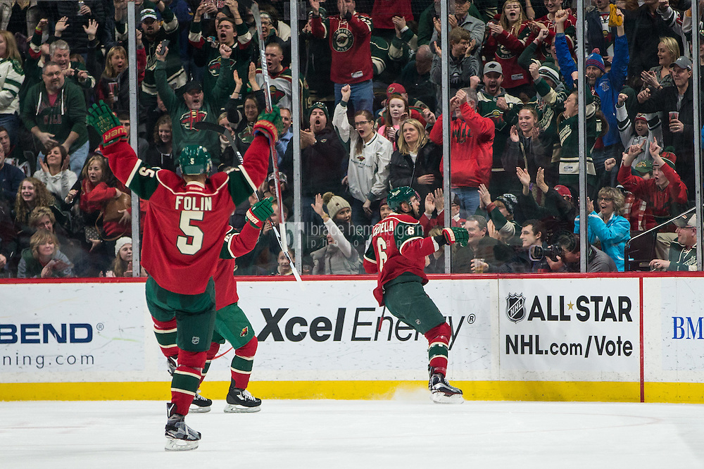 Dec 29, 2016; Saint Paul, MN, USA; Minnesota Wild defenseman Marco Scandella (6) celebrates his goal during the first period against the New York Islanders at Xcel Energy Center. Mandatory Credit: Brace Hemmelgarn-USA TODAY Sports