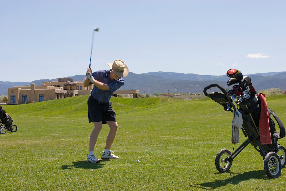 Golfer swings at Taos Country Club
