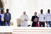 Vatican City june 22th 2016, weekly general audience. In the picture Pope Francis invites refugees to join him on stage at general audience