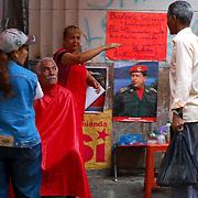 VENEZUELAN POLITICS / POLITICA EN VENEZUELA<br /> Street barber / Barberia en la calle<br /> Caracas - Venezuela 2009<br /> (Copyright © Aaron Sosa)
