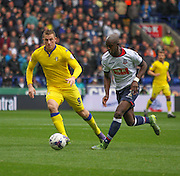 Chrid Wood and Prince Gouano battle during the Sky Bet Championship match between Bolton Wanderers and Leeds United at the Macron Stadium, Bolton, England on 24 October 2015. Photo by Pete Burns.
