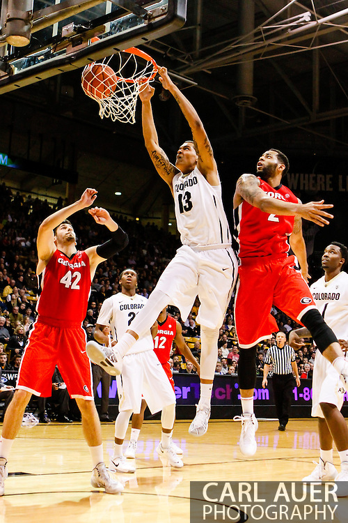 December 28th, 2013:  Colorado Buffaloes freshman forward Dustin Thomas (13) throws down a put back dunk off of a missed Colorado shot past Georgia Bulldogs redshirt junior forward Marcus Thornton (2) in the second half of action in the NCAA Basketball game between the Georgia Bulldogs and the University of Colorado Buffaloes at the Coors Events Center in Boulder, Colorado
