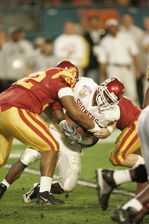 University of Southern California defensive lineman Manuel Wright tackles Oklahoma University running back Adrian Peterson during USC's 55-19 victory over Oklahoma on January 4, 2005 in the FedEx Orange Bowl at Pro Player Stadium in Miami, Florida.