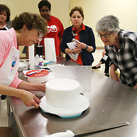 Lauren Wood | Buy at photos.djournal.com<br /> Rita Hendrix of Cakes by Rita in Nettleton demonstrates different cake decorating techniques during the Cake Decorating class of the Mud and Magnolias Home and Garden Expo Saturday morning at the ICC Belden campus.