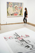 Girlfriends 1965-6 - Alibis a Sigmar Polke retrospective at the Tate Modern – he was viewed as one of the most experimental artists of recent times and the exhibition covers his full career, bringing together works from around the world in a huge variety of materials. Highlights include: Girlfriends – An iconic early Pop painting from 1965 of a bikini-clad girl; Potato House – Standing over 6 feet tall, this sculpture of a house is made from wooden lattices covered in real potatoes; Mao – A huge felt banner covered in scraps of cloth and painted with an image of Chairman Mao; Watchtowers – A series of neon-coloured paintings incorporating silver, resin, fabric and bubble-wrap; and other paintings made from such diverse materials as meteorite dust, soot, lead, coal, elastic bands and medical tape. The exhibition runs from 9 October 2014 – 8 February 2015.  Tate Modern, Bankside, London, UK 07 Oct 2014.