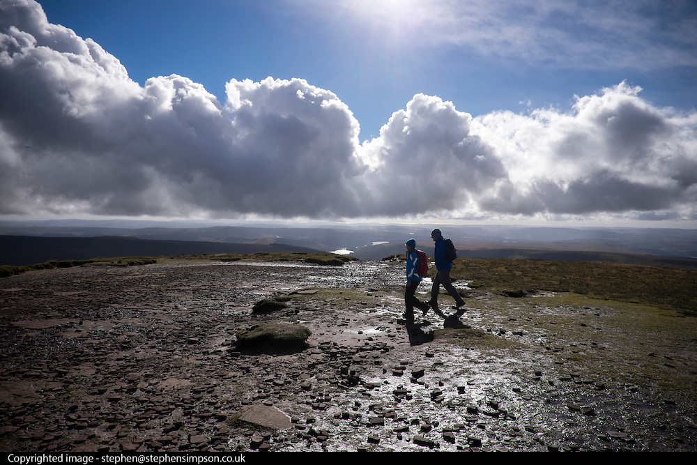 © Licensed to London News Pictures. 15/10/2016. Brecon Beacons, UK Clouds over walkers in showery and bright weather on Fan Y Big in the `Brecon Beacons National Park. Photo credit : Stephen Simpson/LNP