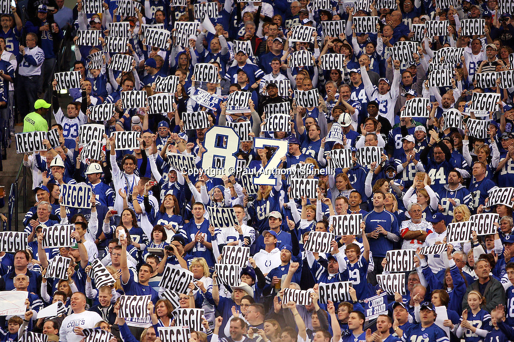 Indianapolis Colts fans hold up hundreds of Reggie signs in support of Colts wide receiver Reggie Wayne (87) during the AFC Championship football game against the New York Jets, January 24, 2010 in Indianapolis, Indiana. The Colts won the game 30-17. ©Paul Anthony Spinelli