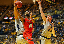 Feb 26, 2018; Morgantown, WV, USA; Texas Tech Red Raiders guard Niem Stevenson (10) shoots underneath the basket during the first half against the West Virginia Mountaineers at WVU Coliseum. Mandatory Credit: Ben Queen-USA TODAY Sports