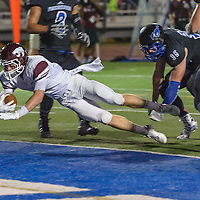 Clear Creek #2 Bradon Hower leaps to cross over the goal line to score against Friendswood during the game at Winston Stadium in Friendswood 10/17/14