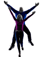 one caucasian couple senior  jumping happy silhouette  in silhouette studio isolated on white background