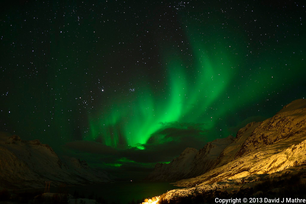 Early Morning (00:02 AM) Northern Lights on Kvaløy Island near Tromsø. Image taken with a Nikon D800 and 24 mm f/1.4 lens (ISO 800, 24 mm, f/2, 8 sec)..