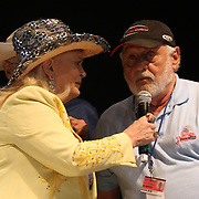 Lynn Anderson performs with the Leroy Van Dyke Country Gold Tour. Anderson plucks Paul Schuette from the crowd for a sing along. Food and rides are the main attraction around the midway of the South Florida State Fair. <br /> Photography by Jose More
