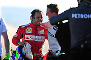 Felipe Massa (BRA) gives Michael Schumacher (GER) a hug after the brazilian ran out of fuel and ended the session during the final day of pre-season testing at Circuit de Catalunya in Barcelona, Spain,