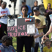 A supporter of the Martin family holds up a sign to show support during a rally for the shooting of Trayvon Martin on Thursday ,March 22, 2012 at Fort Mellon Park in Sanford, Florida. (AP Photo/Alex Menendez) Trayvon Martin rally in Sanford, Florida.