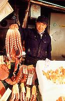 A man presents fresh octopus for sale at the Nijo Ichiba fish market in Sapporo, Hokkaido, Japan.